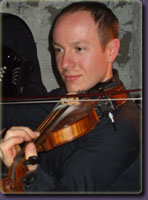 Neil plays the fiddle